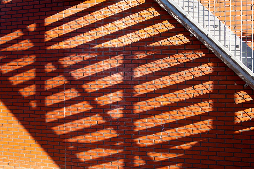 shadows of stairs on brick wall